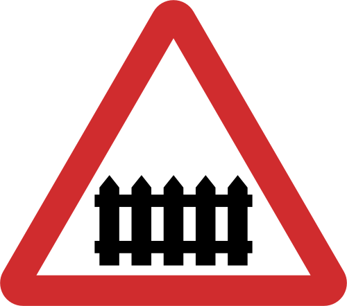 Manned Railway crossing road sign